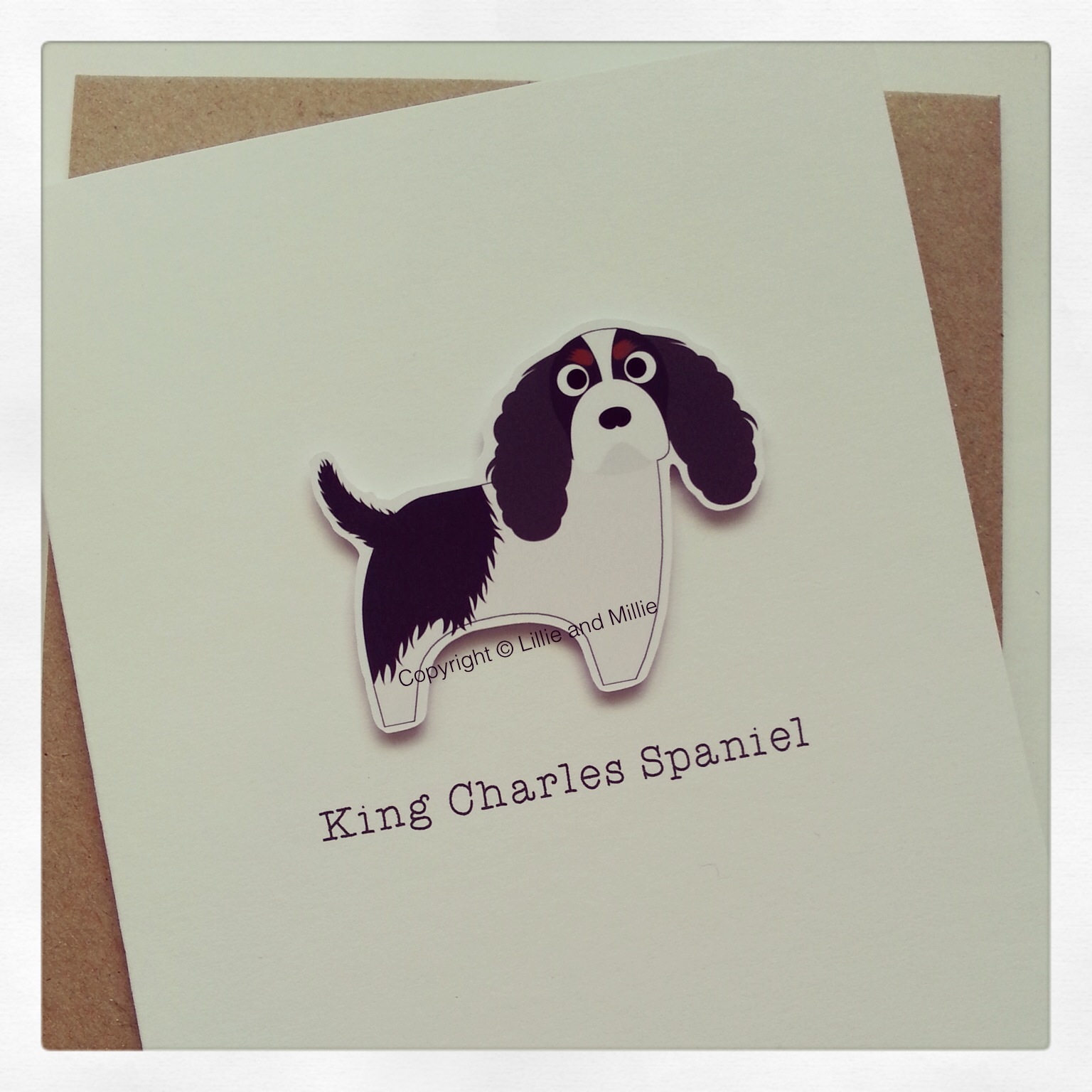 Cute and Cuddly Tri King Charles Spaniel Greetings Card