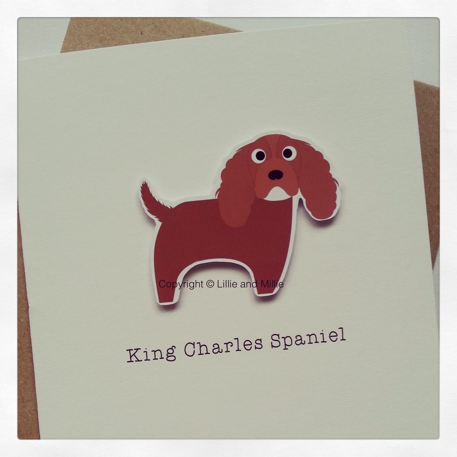 Cute and Cuddly Ruby King Charles Spaniel Greetings Card