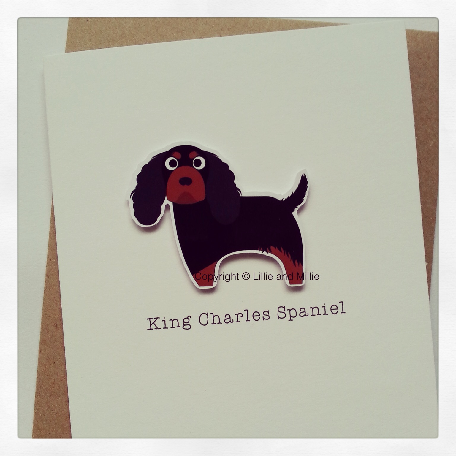 Cute and Cuddly Black and Tan King Charles Spaniel Greetings Card