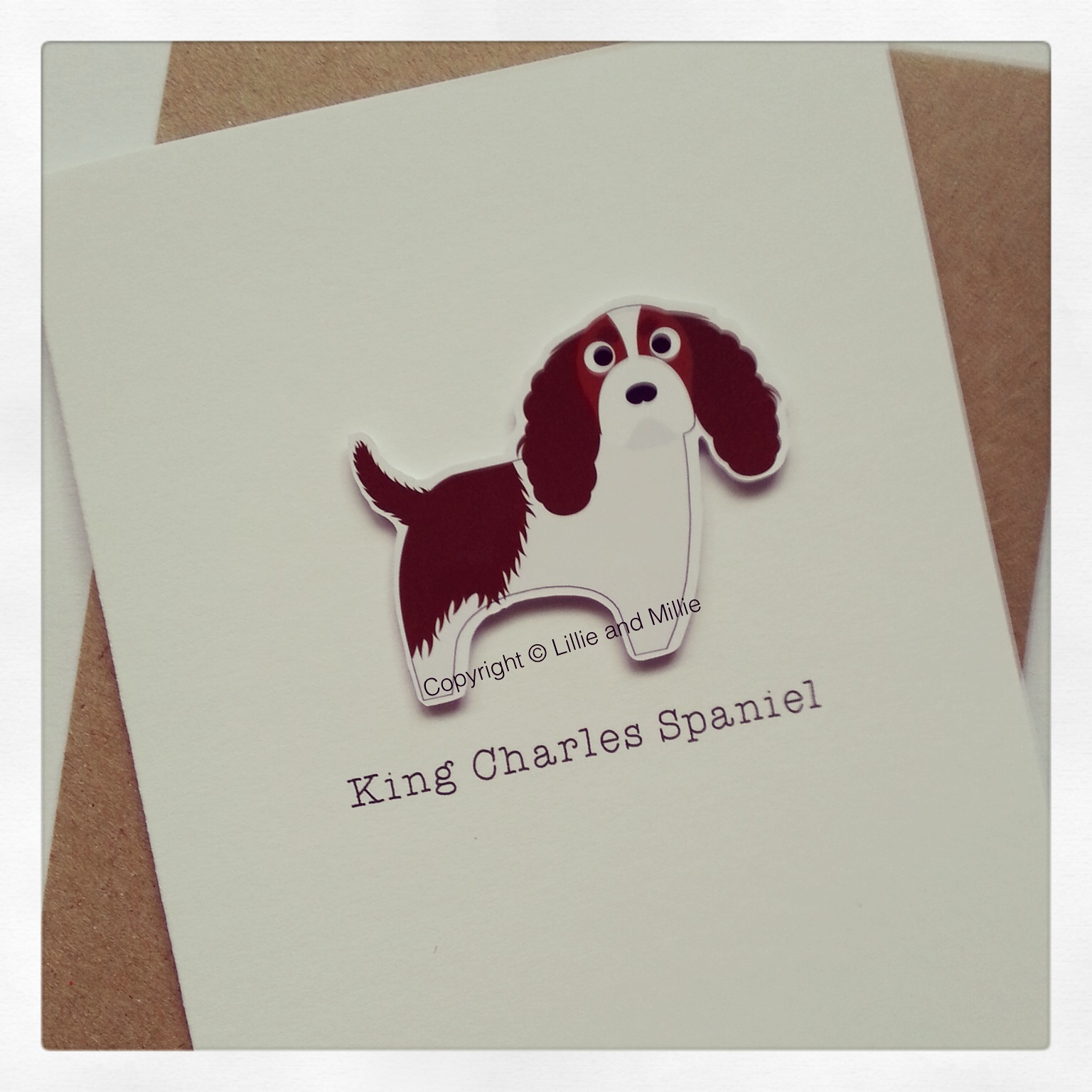 Cute and Cuddly Blenheim King Charles Spaniel Greetings Card